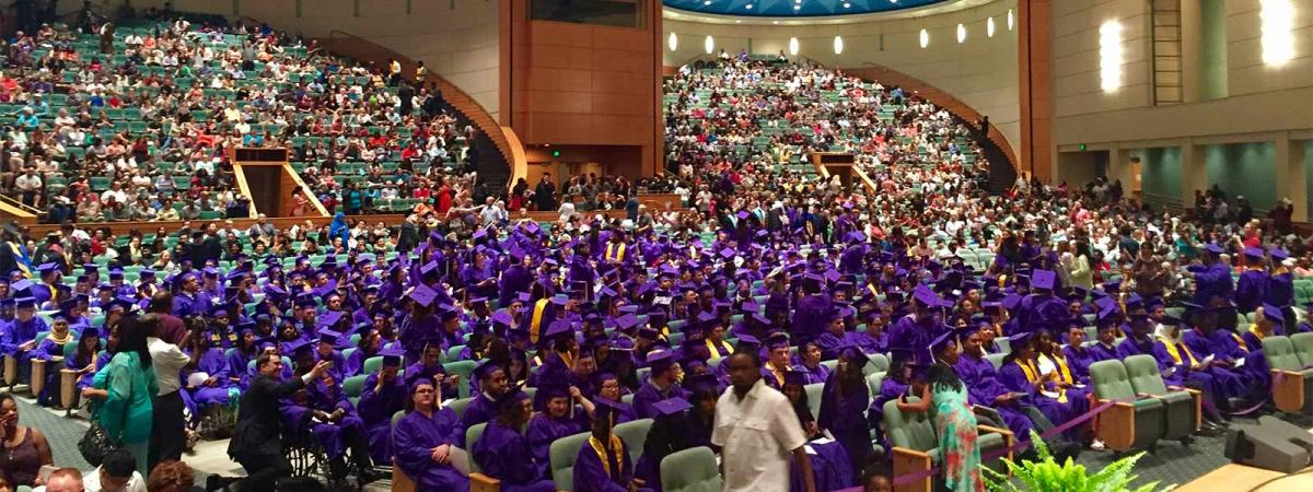 hundreds of people gathered in the audience at the Minneapolis Convention Center for commencement