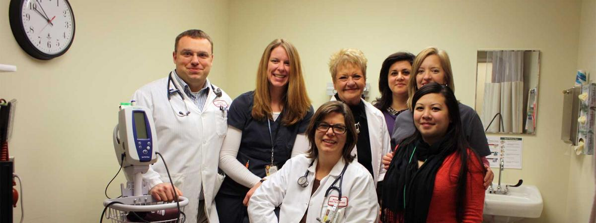 Seven staff posing in the Student Health Clinic at Minneapolis College