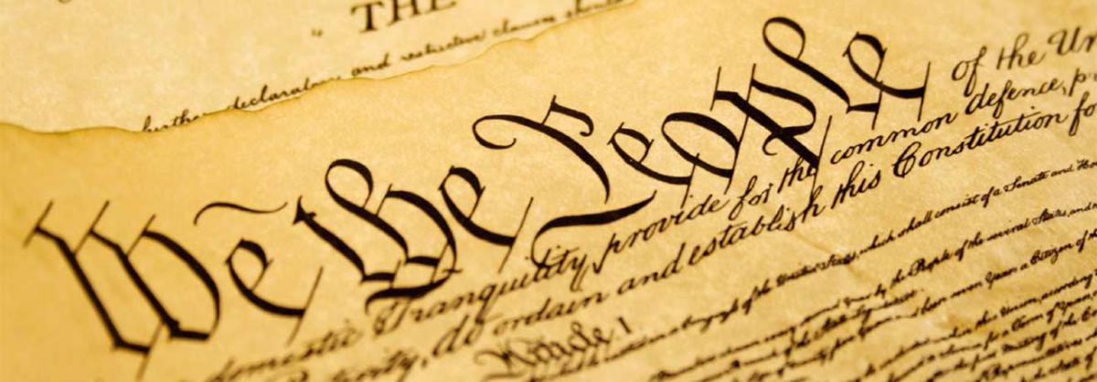 """closeup of """"We the People"""" text of the Constitution"""