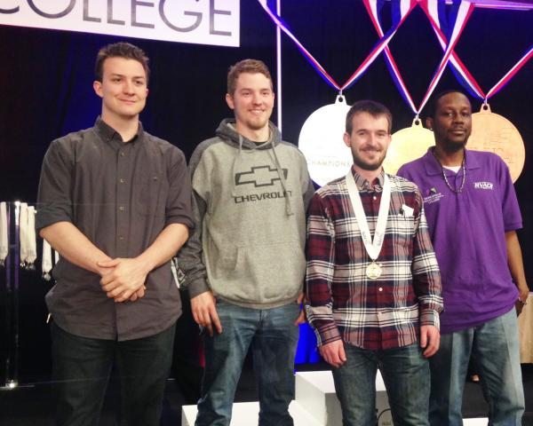 Four standing students from Minneapolis College